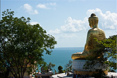 Buddha's Back (Ursula in Aus (Away)) Tags: sky statue clouds thailand temple gold buddha buddhist buddhism wat seated   prachuapkhirikhan bangsaphan thongchai  earthasia  totallythailand   khaothongchai watthangsai