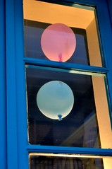 TWO (dimitra_milaiou) Tags: world life pink blue light boy sea 2 orange color love window glass girl smile shop reflections lens island greek happy 50mm design wooden store nikon europe alone colours different village child you d aegean hellas greece together similar f18 shape pure ballons 90 andros cyclades dimitra ormos d90  linescurves   aigaio korthi  korthion  milaiou