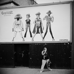 Gorillaz, or 'Advertising Works' (Ian Brumpton) Tags: street urban blackandwhite bw blancoynegro monochrome interestingness noiretblanc britain candid streetlife explore londres camdentown gorillaz thisisengland explored londonstreetphotography flickriver scattidistrada ianbrumpton aimlessstrolling doyathing