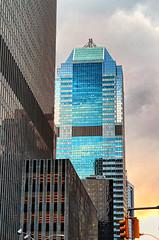 Reaching for the Sky (Gary Burke.) Tags: nyc newyorkcity blue sunset ny newyork building glass skyline skyscraper canon buildings reflections eos rebel colorful skyscrapers manhattan rockefellercenter midtown gothamist dslr offices goldenhour garyburke klingon65 t1i canoneosrebelt1i