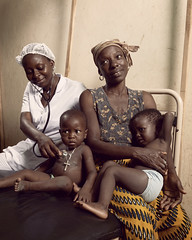 Arielle a nurse in the health center at Athiémé (World Bank Photo Collection) Tags: africa family children holding toddler mother medical health nurse benin gender hold worldbank