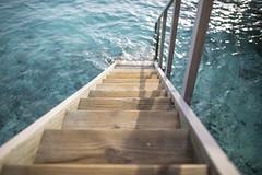 Into the Indian Ocean (Benjamin Griffiths) Tags: ocean wood sunset holiday hot water wooden warm paradise waves indian steps resort splash maldives ras fushi centara