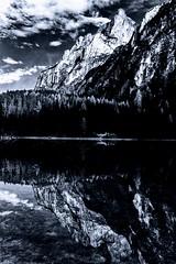 Riflessi sul lago di Braies (u.giommetti) Tags: trees sky blackandwhite italy lake reflection nature alberi clouds canon landscape lago italia nuvole natura cielo riflessi montagna montain paesaggio trentino biancoenero