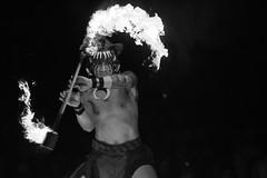 Festival of the Lion King, Fire Twirler 2 (Nickb223) Tags: world show bw white black animal festival fire king lion kingdom disney twirl walt twirler