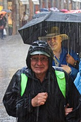 Laughing at the rain (thesilvercitizen) Tags: street italy streets wet water rain smiling laughing photography florence tuscany thunderstorm umbrellas raincoats