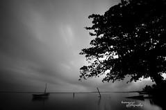 alone withe cloud II (BnW version) (tuan azizi) Tags: blackandwhite cloud seascape landscape tokina malaysia slowshutter scape 1224 kelantan d90 hitamputih flickraward