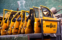 NYC Taxi Doors at Taxi Garage - Sunnyside, Queens (ChrisGoldNY) Tags: city nyc newyorkcity urban newyork cars yellow doors forsale taxis queens repetition posters gothamist cabs sunnyside bookcovers albumcovers garages qns repetitive chopshop thechallengefactory chrisgoldny chrisgoldberg chrisgold chrisgoldphotos