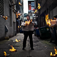 The Stranger. (Austin Tott) Tags: man fire newspaper creative stranger conceptual flaming squarecrop yourbestshot2012