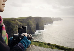 tools of the trade (manyfires) Tags: ocean camera ireland sea selfportrait me scarf self cozy shoreline eire cliffs hasselblad coastline cliffsofmoher atlanticocean countyclare hasselblad500cm