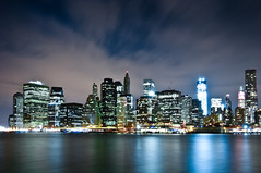 New York 2012 (John Erik) Tags: nyc longexposure urban ny newyork reflection skyline brooklyn night lights nikon cityscape nightshot manhattan financialdistrict brooklynbridge eastriver nikkor bigapple d300 1024mmf3545g