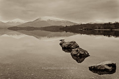Stone by Stone (w.mekwi photography [on the road]) Tags: bw reflection water sepia landscape scotland rocks lochlomond milarrochybay nikkor18105mm nikond7000 wmekwiphotography mekwicom milarrochyrocks