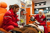 Two volunteers from the Syrian Arab Red Crescent take care of a patient