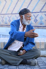 Portraits of Old Age on my Travels Uzbekistan (eriagn) Tags: travel blue portrait man face canon tile eos grey asia sitting hand culture elderly elder silkroad weathered greybeard uzbekistan centralasia samarkand begging asking bluetile crosslegged thestans revered theregistan eriagn ngairelawson nationalgeographicphotojournalism