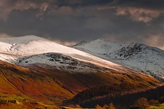 Helvellyn and Stybarrow Dodd from Thirlmere (Explored) (Steve Thompson images) Tags: uk trees winter snow mountains landscape lakedistrict valley cumbria summit helvellyn thirlmere canon70200l polarisingfilter ndgradfilter stickspass stybarrowdodd thedodds canon5dmark2 helvellynridge browncovecrags