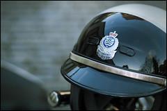 """Servamus"" (Eric Flexyourhead) Tags: city urban canada detail vancouver reflections downtown bc bokeh britishcolumbia helmet victorysquare 45mm fragment vancouverpolice zd vpd servamus olympusep1 motorcyclesquad mzuikodigital45mmf18"