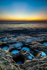 Coquina Twilight (John Cothron) Tags: 2jtrip20121 35mm 5dmkii atlanticocean canon cothronphotography distagont2821 flaglercounty florida guanatolomatomatanzasnationalestuarineresearchreserve johncothron palmcoast sunshinestate washingtonoaksgardensstatepark ze zeissdistagont21mm28ze beach calcite coquina dawn landscape morninglight ocean rock saltwater sand scenic seashells spring sunrise twilight water wave johncothron img09074120406 seascape