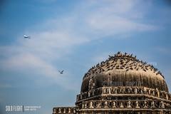 Solo Flight (suniljee) Tags: sky india monument architecture plane ancient pigeon aircraft delhi pigeons flight bluesky mosque aeroplane solo moghul soloflight