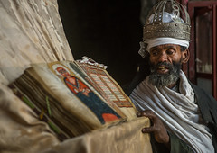 Ethiopian orthodox priest with an old bible in nakuto lab rock church, Amhara region, Lalibela, Ethiopia (Eric Lafforgue) Tags: africa people man color church horizontal silver religious reading book clothing day adult african faith religion monk christian unescoworldheritagesite holy indoors monastery devotion bible civilization crown priest christianity shawl spirituality ethiopia oneperson developingcountry gez lalibela engravings hornofafrica geez ethiopian eastafrica orthodoxchurch abyssinia manuscripts traditionalclothing realpeople cavechurch waistup adultonly onematuremanonly traveldestination 1people africanculture amhararegion ethio161338