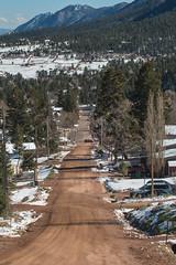Palmer Lake street (Michael Karlik) Tags: road trees winter mountain lake snow colorado mud hill palmer front dirt evergreen range