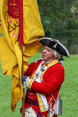 Standard Bearer (Oleg S .) Tags: red people history yellow costume flag military
