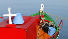 colorful boat (maria xenou~photodromos~) Tags: blue red sea sunlight green rot water colors sunshine meer wasser mediterranean colours weekend greece simplicity grn blau griechenland wochenende bluesea fischerboot mittelmeer einfachheit        colorfulboat    canoneos1100d