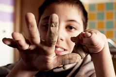 mani in pasta! (TIMPICE) Tags: school boy portrait people ceramica face student nikon hand mani ritratto laboratorio scuola scultura d90