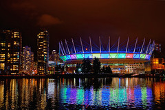 BC Place comes alive with light and colors (どこでもいっしょ) Tags: city light canada motion building colors skyline vancouver reflections bc nightshot general sony led za hdr olympicvillage bcplace carlzeiss primelens falescreek emount sel24f18z sonynex5n thevillageonfalescreek carlzeiss24mmf18lens sonnart1824 2012illuminateyaletown