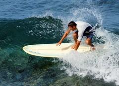 Catching a wave (Kai Eiselein) Tags: ocean boy sea man male sports sport hawaii surf minolta pacific surfer sony maui surfing surfboard alpha athlete amount 80200 watersport honoluabay westmaui hsg a700