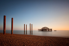 West Pier (TheFella) Tags: ocean uk longexposure greatbritain sunset sea england slr beach digital photoshop canon skeleton eos evening coast pier photo brighton europe unitedkingdom dusk hove columns shell landmark pebble westpier burnt photograph processing slowshutter gb 5d dslr pillars eastsussex englishchannel markii postprocessing brightonandhove thefella 5dmarkii conormacneill thefellaphotography