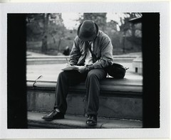 Man Writing in the Park (Morgan C) Tags: new york city nyc b mamiya film polaroid photography back fuji c 45 f45 iso instant fujifilm fp 3000 rb67 180mm sekor fp3000b