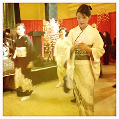 traditional vs. modern. (bondidwhat) Tags: nyc newyorkcity modern traditional culture cellphone kimono texting iphone cultureclash japanweek mobilephotography iphoneography hipstamatic
