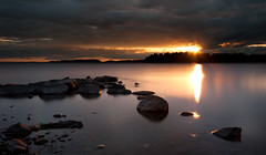 Mrudden - Sunset (- David Olsson -) Tags: longexposure sunset sun lake nature water landscape nikon rocks sundown bright cloudy sweden stones sigma le april 1020mm dramaticsky 1020 vnern darkclouds 2012 dx hammar vrmland ndfilter lakescape smoothwater heavyclouds widecrop skoghall d5000 mrudden davidolsson nd500 lightcraftworkshop 2exposuremanualblend