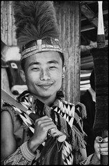 Nagaland Man_9319 (hkoons) Tags: portrait blackandwhite bw music india festival beads dance costume dress arms native song knife monotone sharp demonstration weapon sing saber instrument sword tribes tune tribe armory instruments ethnic centralasia hornbill regional rhythm naga chant kohima nagaland heritagevillage northeastindia angami hornbillfestival pochury morung heritagecomplex nagaheritagevillage
