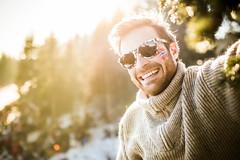 Hanging Out (Morten Falch Sortland) Tags: portrait sun snow man ski tree sports nature smile sunglasses oslo norway beard student photographer skiing no flag events young shades norwegian countries climbing flare crosscountryskiing raybans holmenkollen oslocity photomortenfalchsortland holmenkollenstafetten