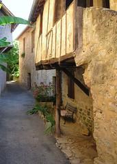 Petit coin tranquille (Doonia31) Tags: terrasse banc village france autoire calme pierres rue colombages maison jardinire fleurs