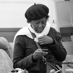 Cold (Akbar Simonse) Tags: street people urban bw woman holland netherlands monochrome amsterdam scarf square zwartwit candid tissue streetphotography cellphone streetshot straat baret straatfotografie straatfoto straatfotograaf dedoka akbarsimonse