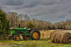 Getting to be that time of year. (Trigger Happy Girl Photography) Tags: trees tractor green field grass clouds canon fence farming tires hay challengeyouwinner friendlychallenges stuckinthemoment veronicamphotography