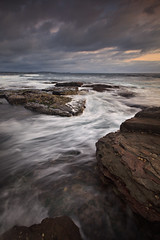 Outer Reef (Xenedis) Tags: ocean cloud seascape water rock dawn australia nsw newsouthwales reef surge longreef