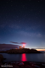 Nubble Nights (moe chen) Tags: ocean york light red lighthouse night sunrise way stars island rocks maine atlantic moe cape milky chen neddick nubble