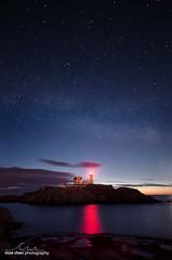 Nubble Nights (moe chen) Tags: ocean york light red lighthouse night sunrise way stars island rocks maine atlantic moe cape milky chen neddick nubble