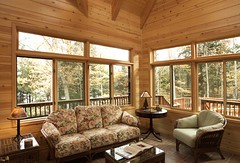 Sunroom (North Twin Builders) Tags: wood flowers trees windows summer brown lake tree green fall window lamp pine tile table book fan maple construction chair cabin warm candle view natural tan ceiling beam livingroom couch eagleriver spindles walls railing remodel custom coffeetable wicker railings contractor beams sunroom builder tg northwoods paneling transom decorated knottypine endtable tonguegroove baluster customhome woodceiling northernwi lakehome custombuilder northtwinbuilders