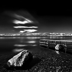 Moving in Black and White (Rilind Hoxha) Tags: blue mountain lake different serenity deepbluesky longexpo calmlake ohridlake 10stops nd10 calmscene daytimelongexpo longexposureintheday nationalparkmaceonia ohridlakephotography
