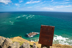 No Land for Miles (Jocey K) Tags: ocean blue sea newzealand sky green water sign clouds islands words rust rocks pacificocean nz northisland northland tasmansea capereinga aupouripeninsula