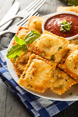 Homemade Fried Ravioli with Marinara Sauce (brent.hofacker) Tags: red food hot cheese bread stuffed healthy italian sauce traditional spice tasty pasta fresh meat gourmet delicious homemade butter oil pastry basil cooked fried herb seasoning unhealthy dumpling ravioli toasted prepared marinara breading marinarasauce friedravioli