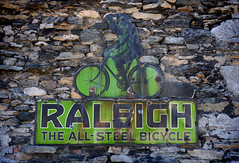 Raleigh The All-Steel Bicycle, Cartmel, Cumbria (Larry Carr) Tags: color colour sign wall rusty fujifilmxe1