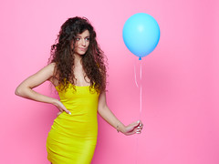 Young and beautiful curly girl in a yellow dress on a pink background holding blue balloon and laughs (noor.khan.alam) Tags: birthday pink blue party portrait people woman white holiday cute beautiful beauty smile fashion yellow lady female hair studio fun happy person model holding pretty dress emotion expression joy balloon young lifestyle style happiness celebration curly helium gift attractive leisure positive elegant cheerful belarus celebrate isolated caucasian