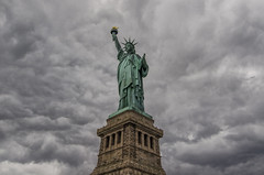 Statue of Liberty (Brandon Godfrey) Tags: nyc newyorkcity newyork clouds grey outdoor overcast landmark icon statueofliberty iconic cloudscape ladyliberty