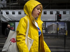 To Boldly Go (Leanne Boulton) Tags: life street city uk light shadow portrait people urban woman color colour detail texture wet face rain weather yellow closeup female canon 50mm scotland living colorful natural bright humanity bokeh outdoor expression glasgow vibrant candid culture streetphotography vivid streetlife scene depthoffield human shade 7d colourful splash raining raincoat society tone facial candidportrait bokehlicious candidstreetphotography