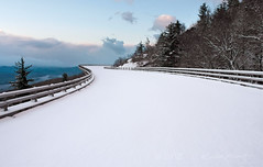 Snow on the Linn Cove Viaduct (R. Keith Clontz) Tags: morning snow clouds northcarolina bluesky hawksbill blueridgeparkway tablerock grandfathermountain mountainridges linncoveviaduct balsamtrees rkeithclontz blueridgepics fraserfirtrees blueridgelight