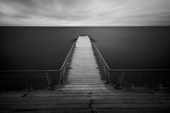 desolate (Andreas Lf) Tags: wood longexposure sea blackandwhite bw cloud seascape abandoned monochrome fence wire stair sweden empty jetty horizon tripod overcast le scandinavia desolate malm minimalistic deserted uwa bo01 sigma1020mm ndfilter vstrahamnen neutraldensity djuphavsbadet hitechprostop10 sonyalphaslta77